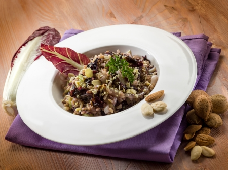 chicory: risotto with chicory and almond, vegetarian food Stock Photo