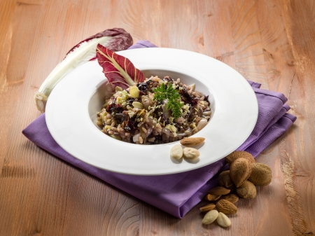 risotto: risotto with chicory and almond, vegetarian food Stock Photo