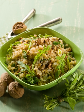 risotto: risotto with arugula and nuts, vegetarian food Stock Photo