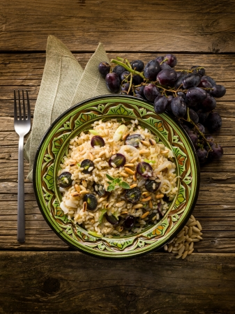 grapes and mushrooms: risotto with mushroom grape and pine cone, vegetarian food
