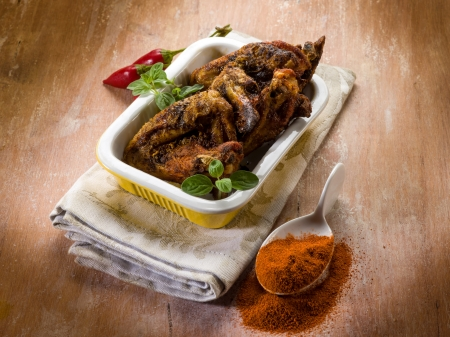 chicken wings baked with paprika spice photo