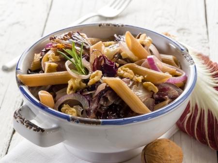 pasta with chicory and nuts, vegetarian food photo