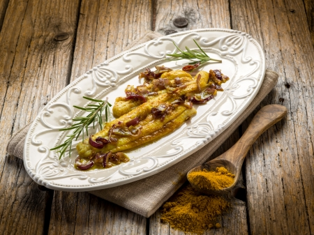 indian cookery: sole fish with curry and onions Stock Photo