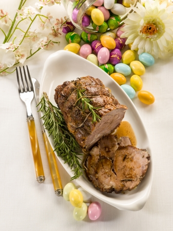 roast lamb: roasted meat over easter table