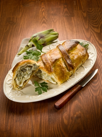strudel with artichoke and ricotta, vegetarian food photo