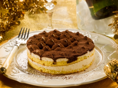 tiramisu over golden table photo