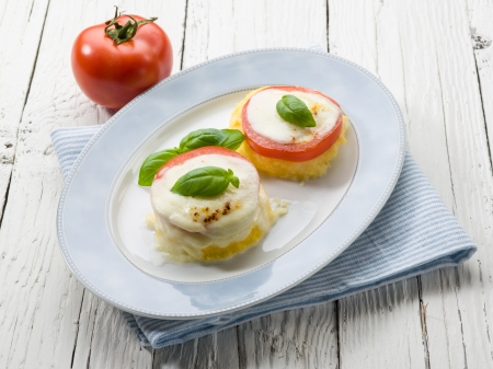 mozzarella tomatoes and porridge, vegetarian appetizer photo