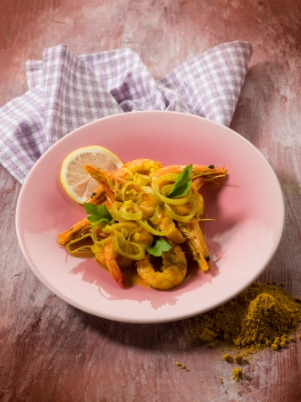 shrimp with curry and onions photo