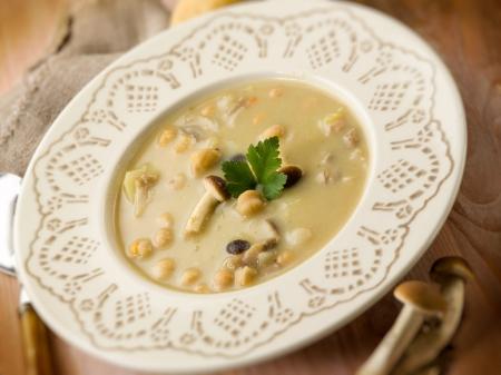 mushroom soup: soup with chickpeas mushroom and potatoes, selective focus
