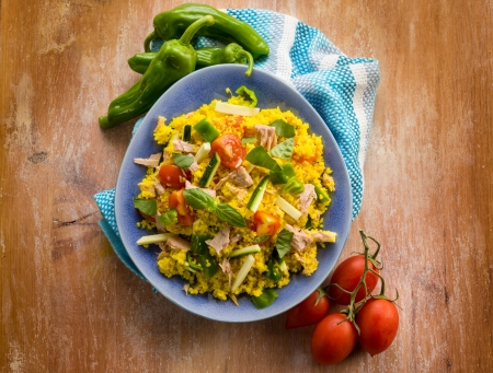 moroccan cuisine: cold sald with couscous tuna zucchinis tomatoes