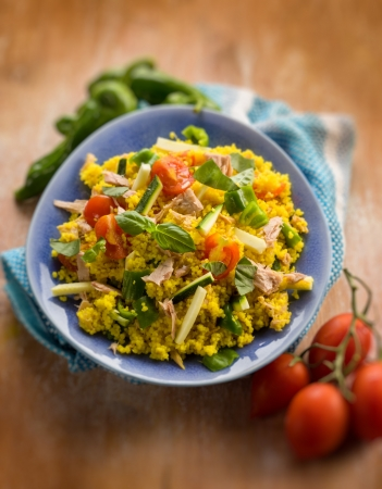 cold sald with couscous tuna zucchinis tomatoes,  selective focus photo