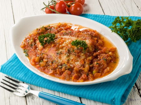 fish fillet with tomato sauce photo