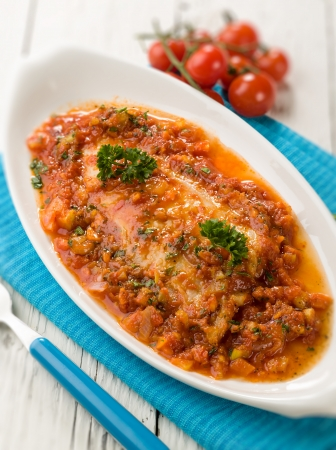 red cooked: fish fillet with tomato sauce,  selective focus