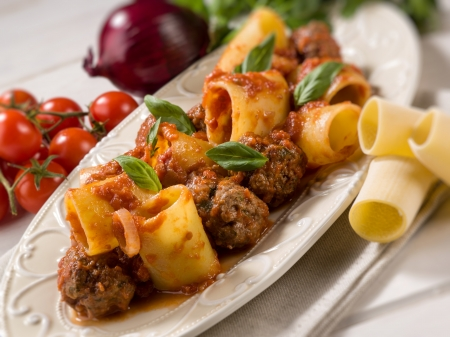paccheri pasta with meatballs, selective focus Stock Photo
