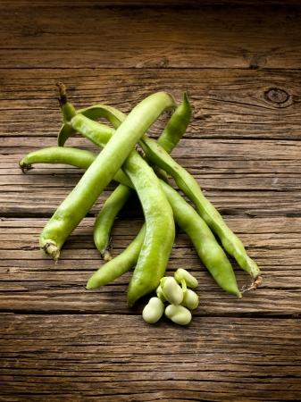 broad: fresh beans broad over wood background