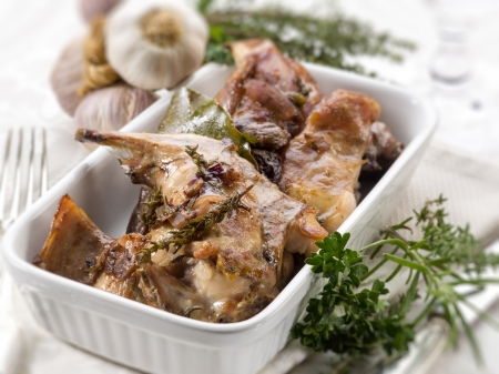 roasted rabbit with herbs and garlic, selective focus Standard-Bild