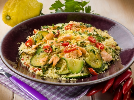 moroccan cuisine: couscous with fresh salmon zucchinis and hot chili pepper Stock Photo