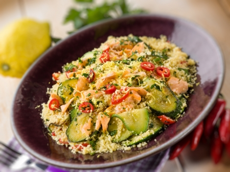moroccan culture: couscous with fresh salmon zucchinis and hot chili pepper, selective focus