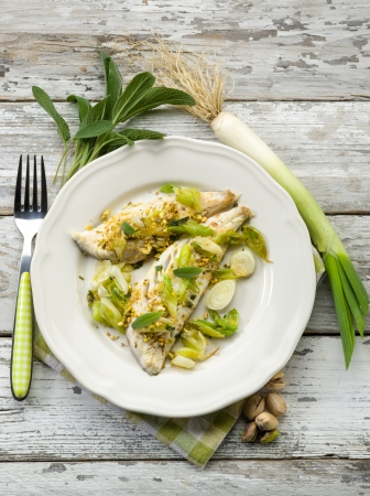 fish fillet with pistachio sage and leek photo