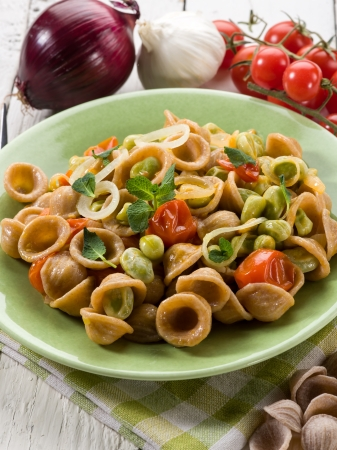 broad: orecchiette with bean broad and fresh tomatoes Stock Photo