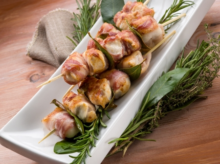 chicken kebab: skewer with chicken and bacon Stock Photo