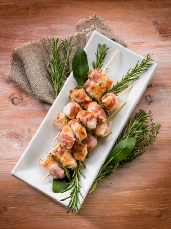 skewer with chicken and bacon photo