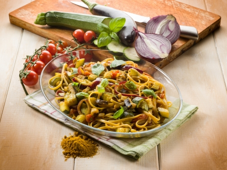 sicilian: pasta with eggplants zucchinis tomatoes and curry