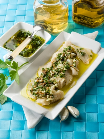 cod fillet  marinated with parsley anchovy and garlic photo