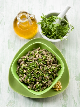integral pasta with arugula pesto photo