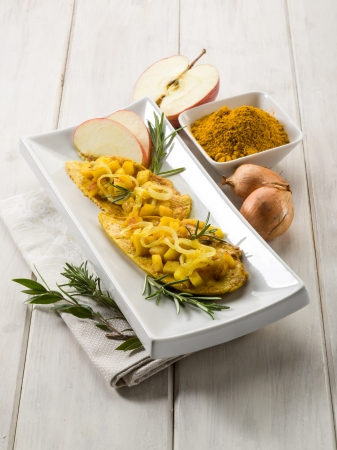 beef curry: escalope with apple onions and curry Stock Photo