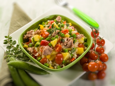 cold rice salad with tuna and pineapple, selective focus photo
