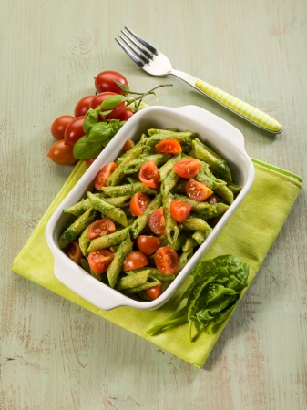 pasta with ricotta spinach pesto and fresh tomatoes photo