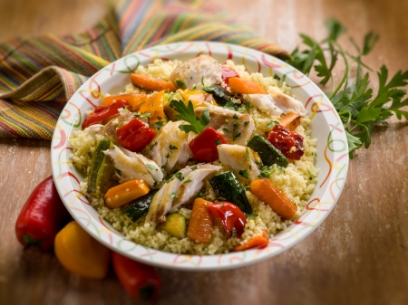 couscous with fish and vegetables, selective focus photo