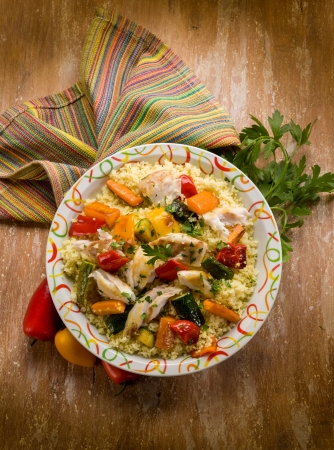 couscous with fish and vegetables photo