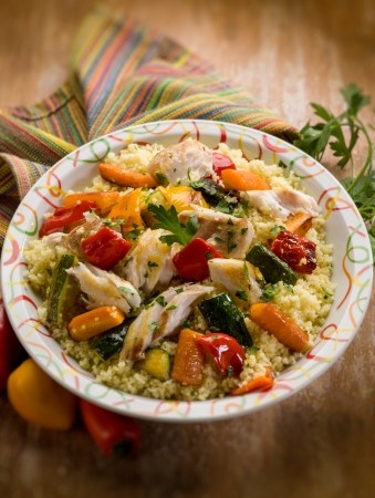 moroccan cuisine: couscous with fish and vegetables, selective focus Stock Photo