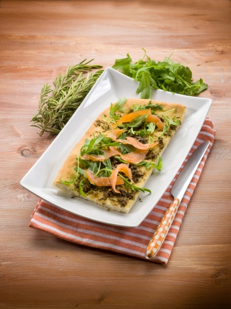 focaccia with smoked salmon arugula and rosemary photo