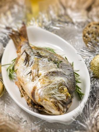 gilthead: grilled gilthead over christmas table Stock Photo