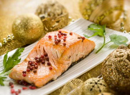 seafood dinner: grilled salmon with pink pepper on christmas table