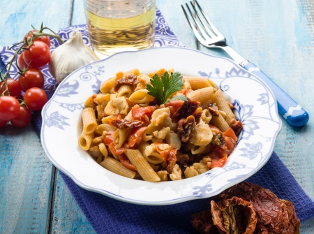 dried fish: pasta with fish ragout and dried tomatoes Stock Photo