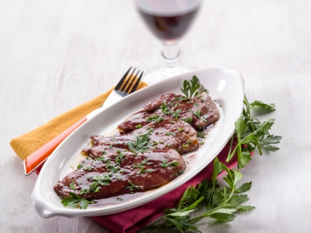escalope cooked with red wine, selective focus Standard-Bild