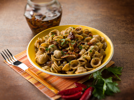 integral: integral orecchiette with dried tomatoes, selective focus Stock Photo
