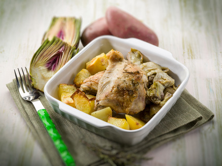 chicken with potatoes and artichoke, selective focus photo