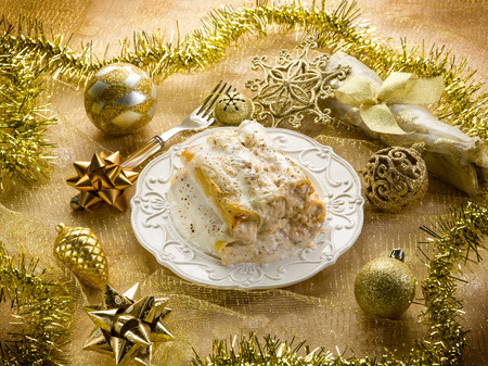 ribbon pasta: cannelloni over golden christmas table