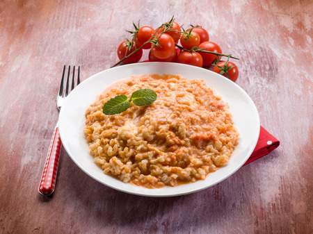 risotto with tomatoes sauce and mozzarella Stock Photo