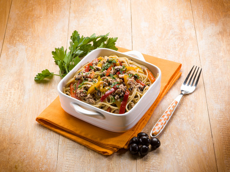 spaghetti with tuna capers olives and peppers photo