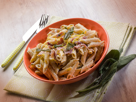 speck: pasta with speck sage and cream sauce Stock Photo