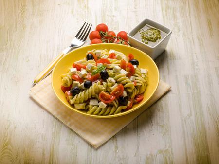 pasta salad: pasta salad with pesto feta tomatoes and black olives