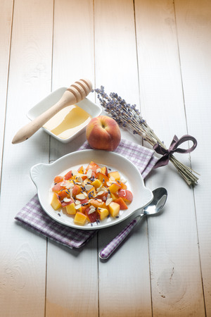 fruity salad: fruit salad with peach almond honey and lavender flower