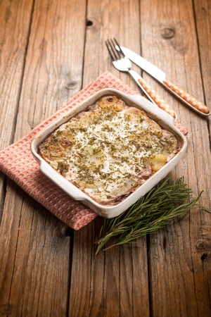 flan with potatoes and red chicory photo