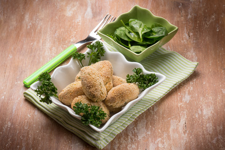 rice croquette with fresh spinac salad